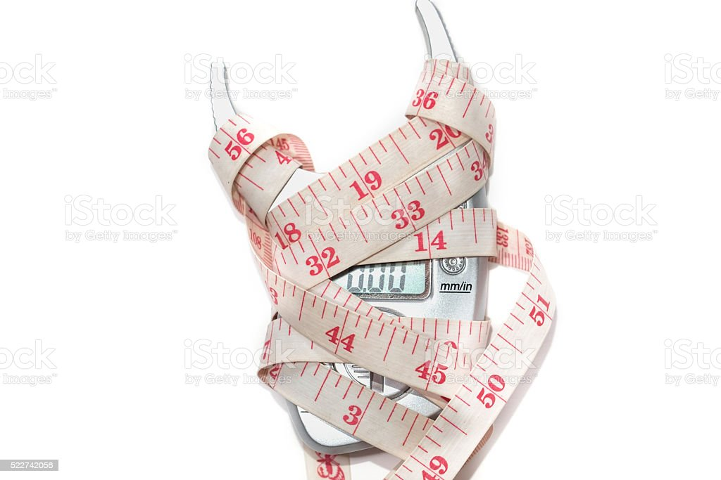 Measure the waist ,fat loss pills and Fat monitor stock photo