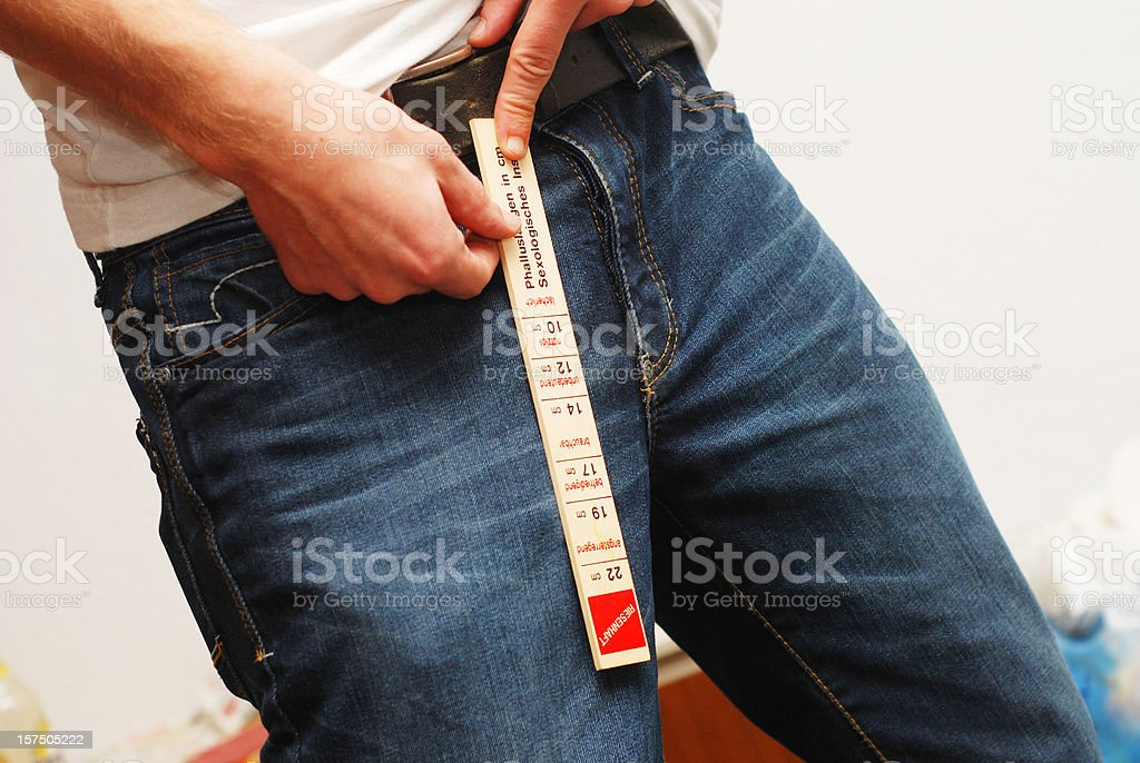measurement of penis - Schwanzlänge stock photo