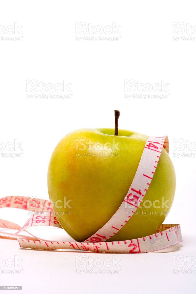 Measurement tape and green apple stock photo