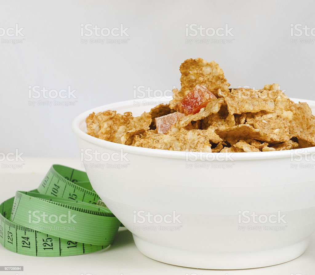 Measurement tape wrapped around dish with flakes/Concept for hea royalty-free stock photo