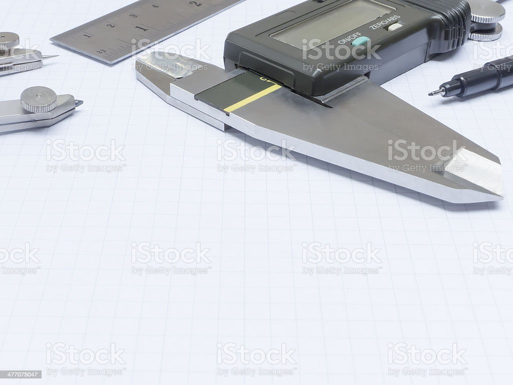Measurement tools on graph paper stock photo