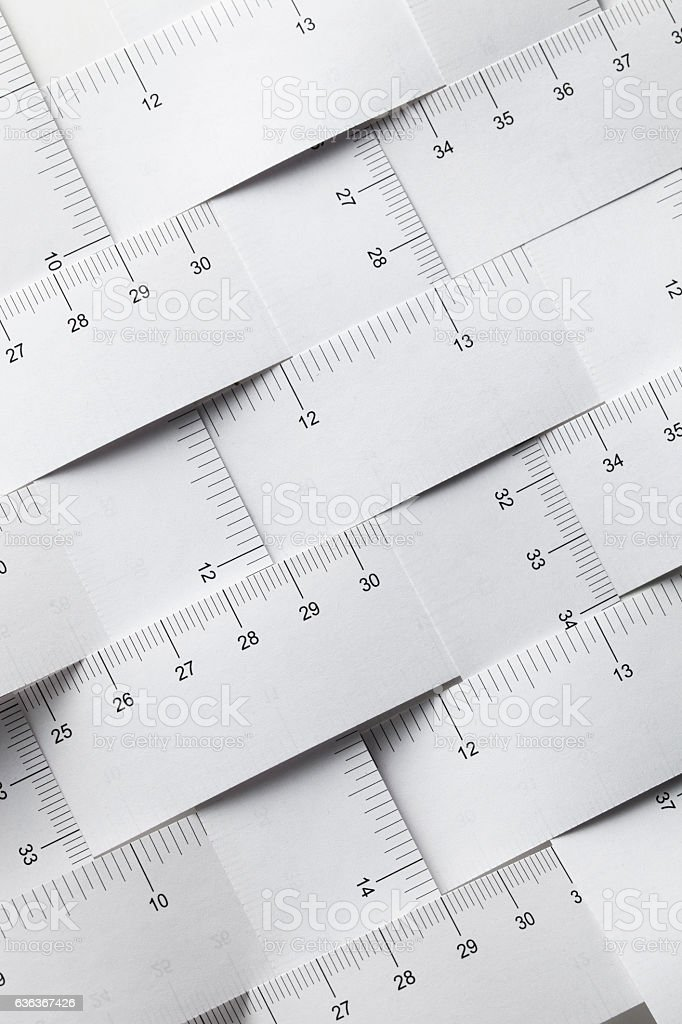 Measurement units. Tape measures in meters and inches. stock photo