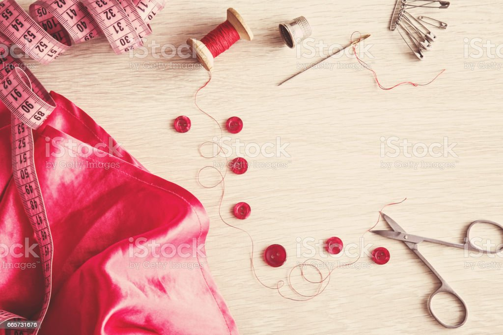 Measurements, cuts and sewing - clothes creation. Sewing works with silk cloth. Handmade. Womanly hobby. stock photo