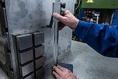 measurements of a steel plate using a planer
