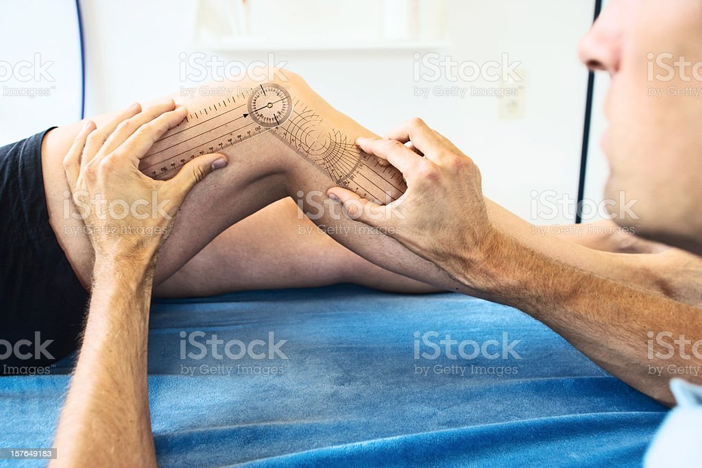 Measuring a knee joint stock photo