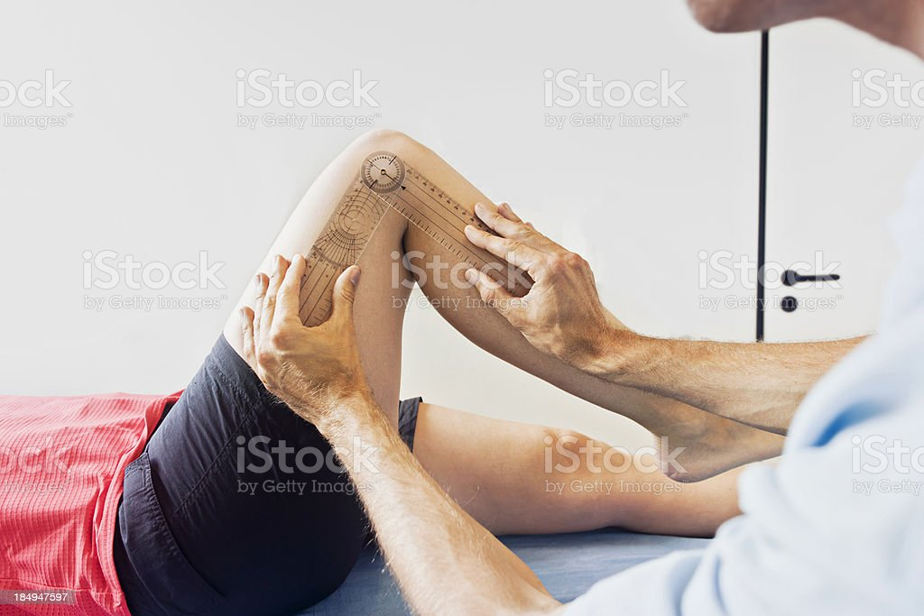 Measuring a knee stock photo