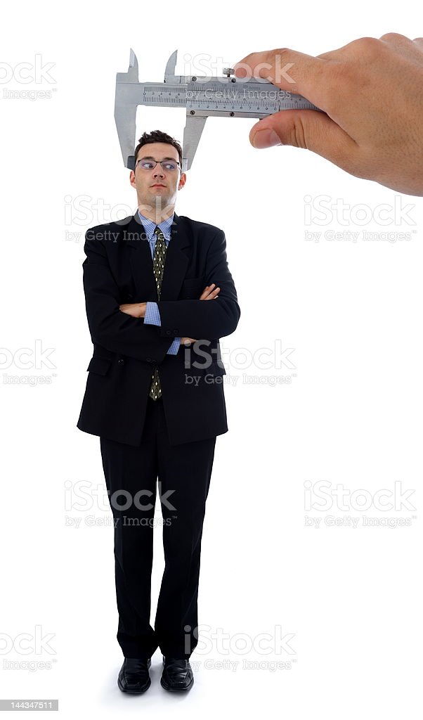 Measuring a men's head royalty-free stock photo