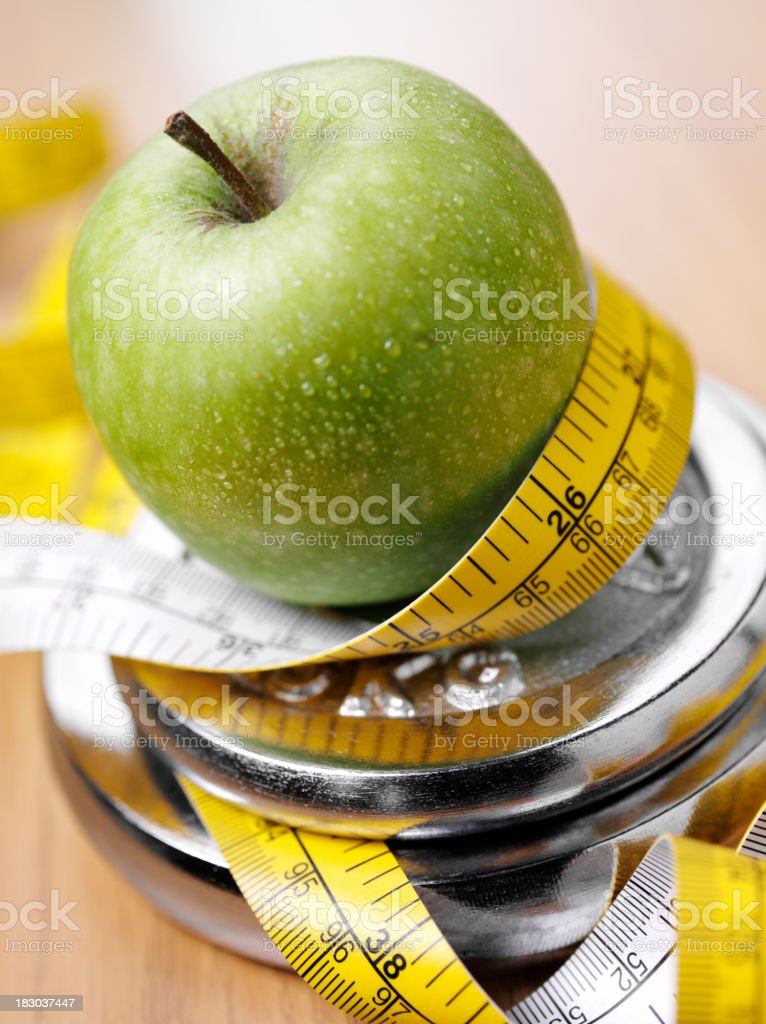 Measuring an Apple on Weights stock photo