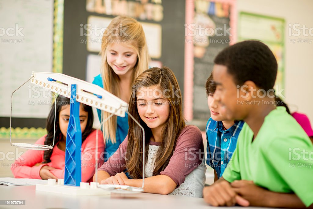 Measuring and Weighing in Class stock photo