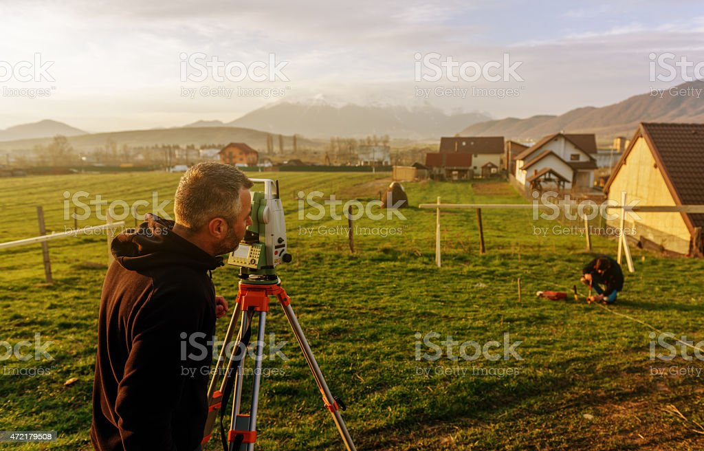 measuring and working on construction site stock photo