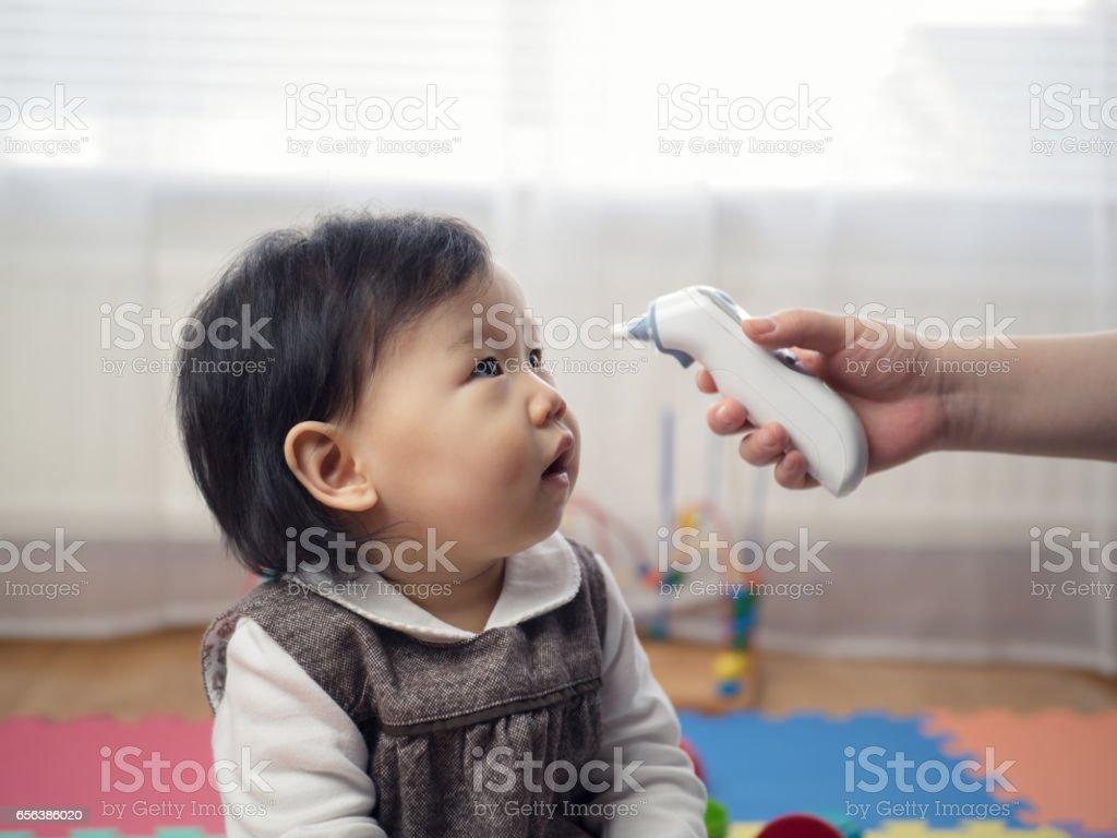 Measuring baby temperature stock photo