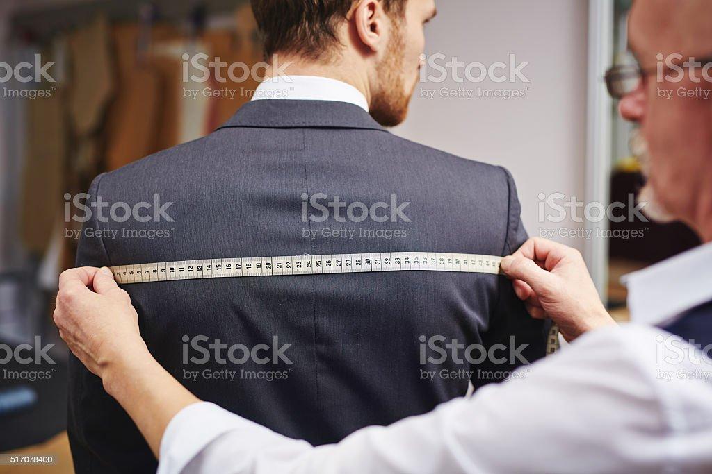 Measuring back of jacket stock photo