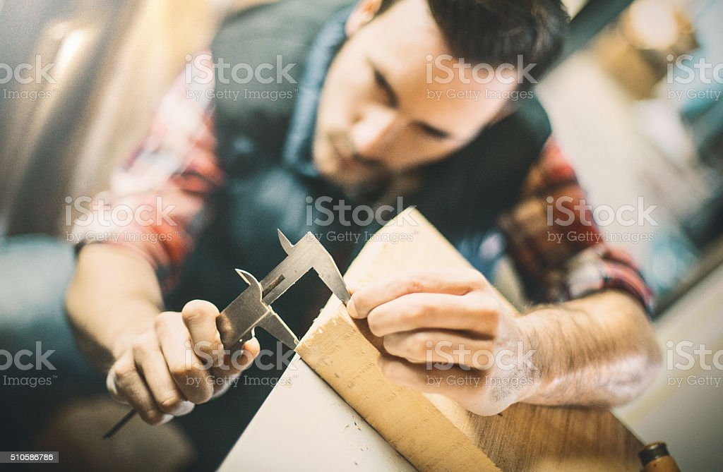Measuring before cutting. stock photo
