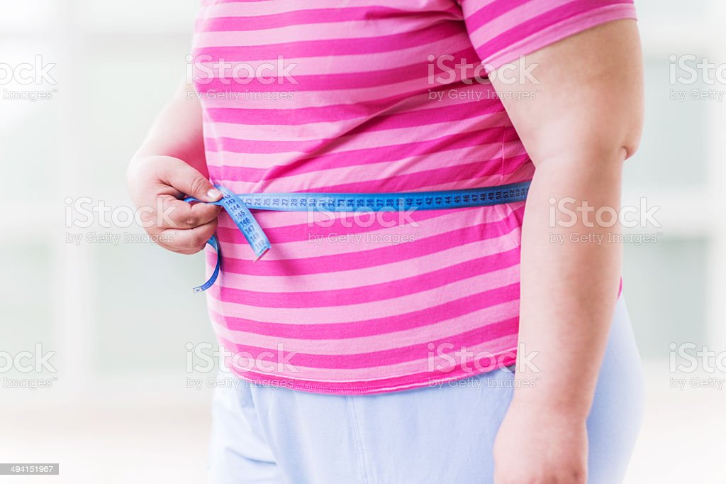 Measuring belly. stock photo