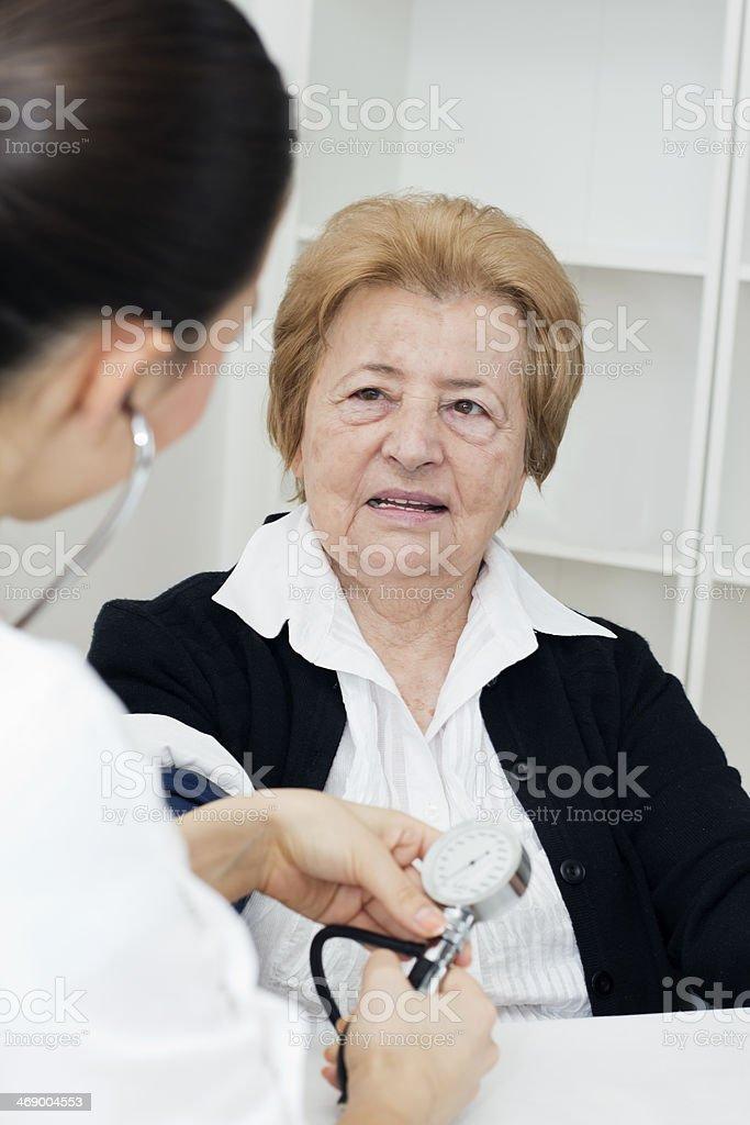 Measuring  blood pressure stock photo