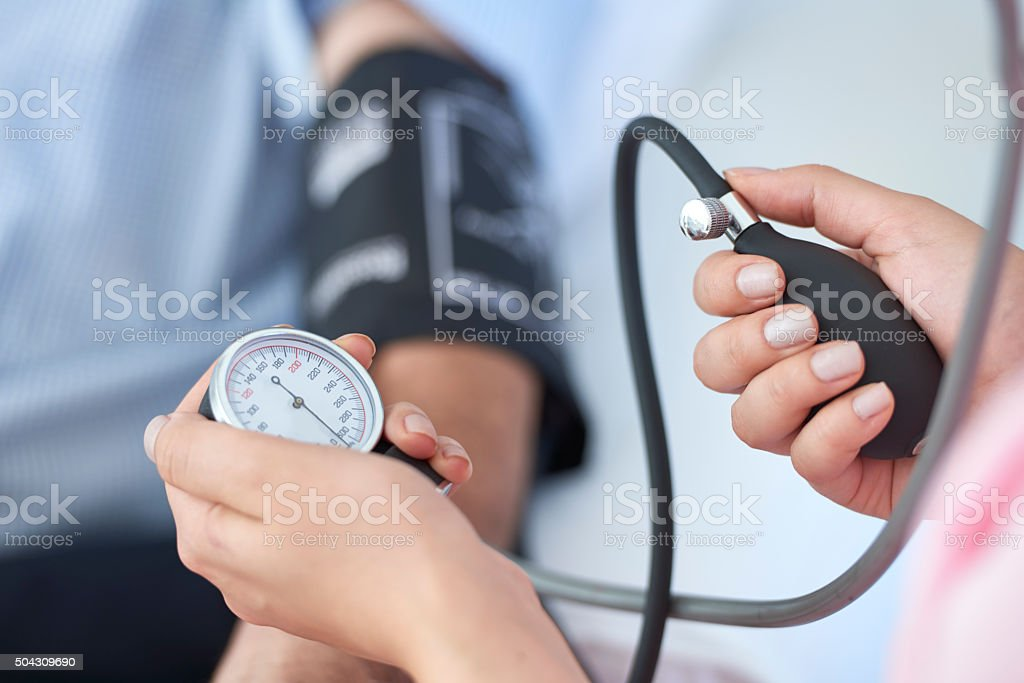 Measuring blood pressure stock photo