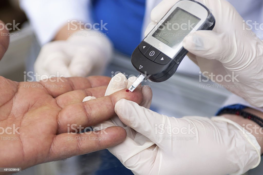 Measuring blood sugar stock photo
