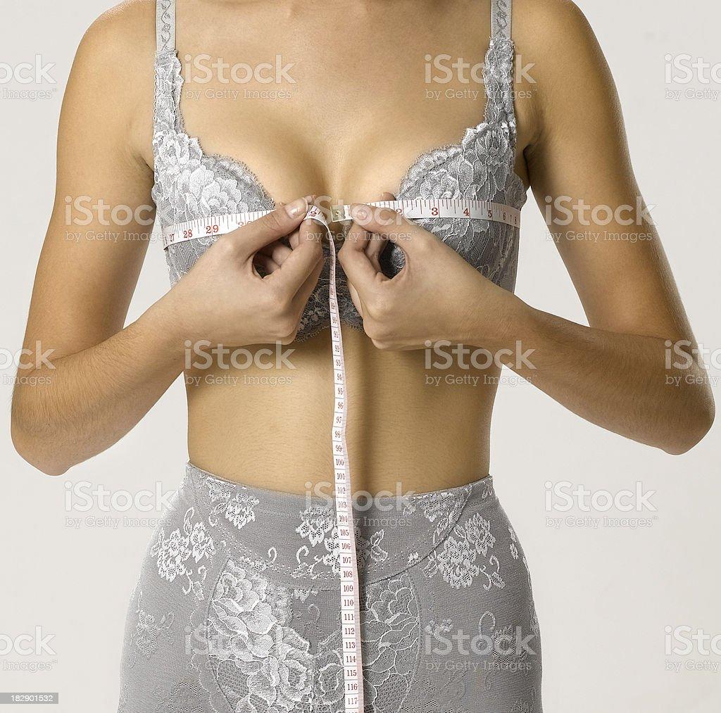 Measuring breast stock photo