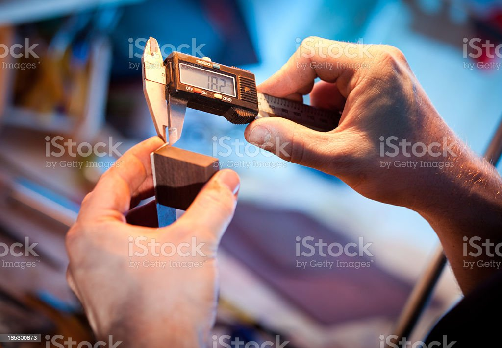 Measuring by electronic slide gauge stock photo