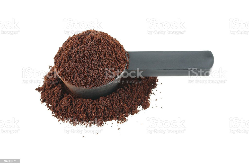 measuring coffee spoon with coffee powder isolated on white stock photo