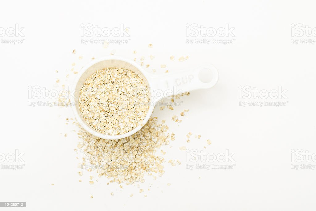 Measuring Cup and Oatmeal stock photo