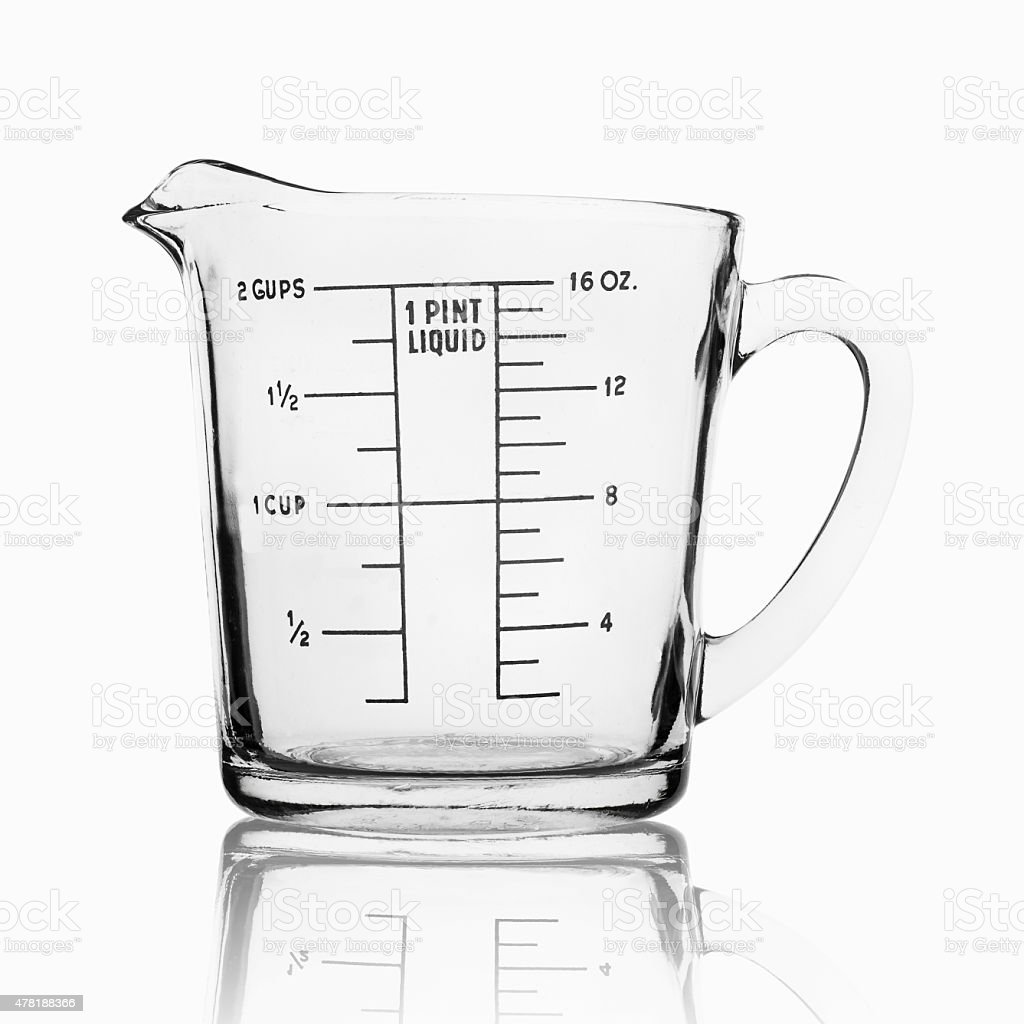 Measuring cup isolated on white background stock photo