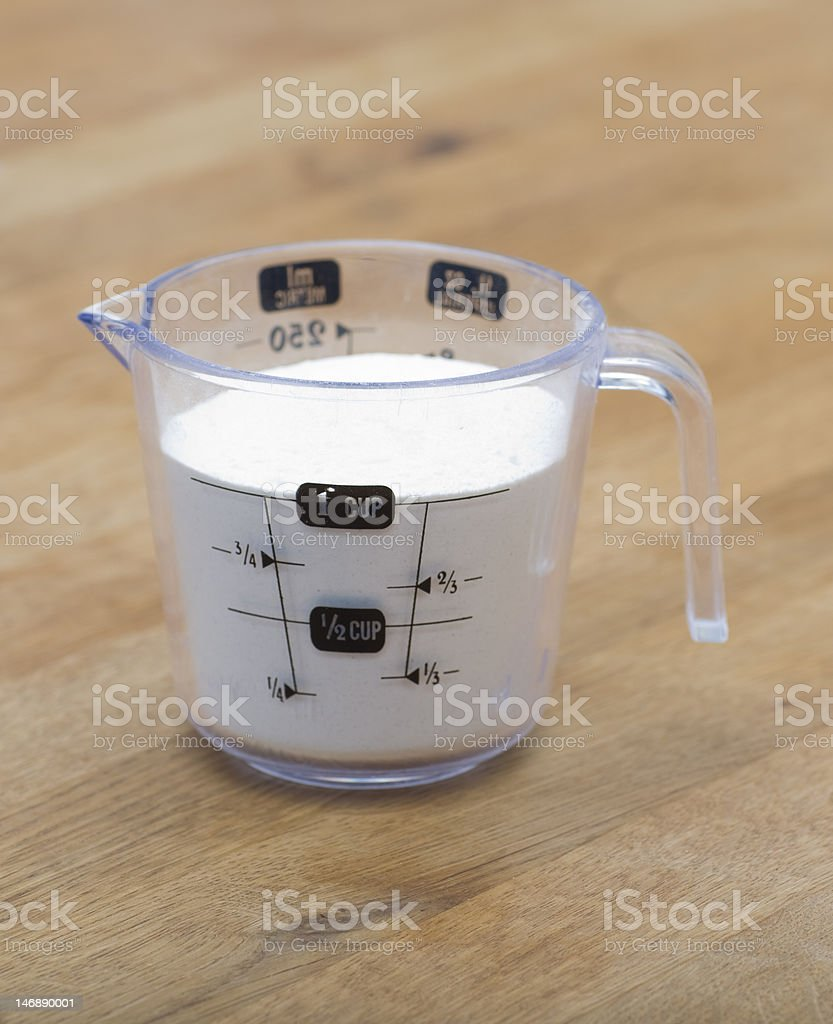 Measuring Cup of Flour stock photo