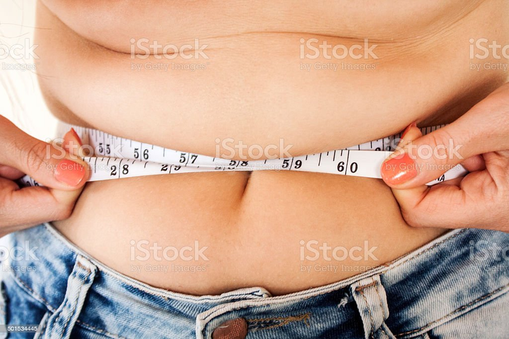 Measuring fatty abdominal stock photo