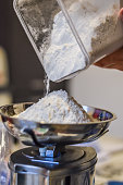 measuring flour on a kitchen scale close up