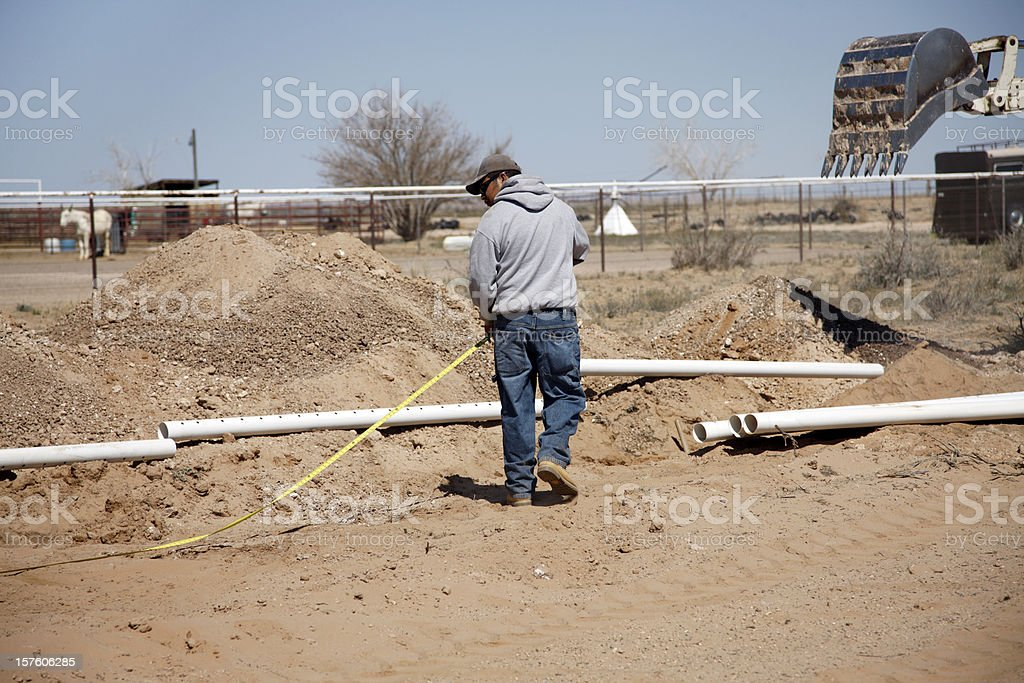 Measuring for Installation of Septic Tank and Drain Field royalty-free stock photo