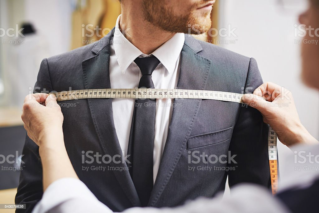 Measuring front of jacket stock photo