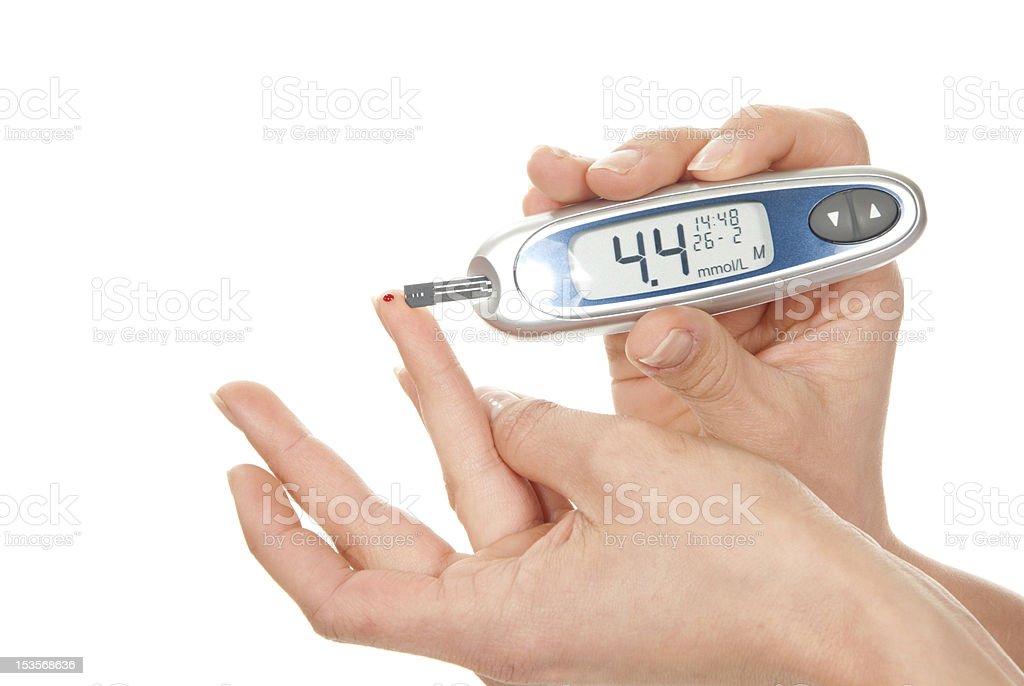measuring glucose level blood test using ultra mini glucometer royalty-free stock photo