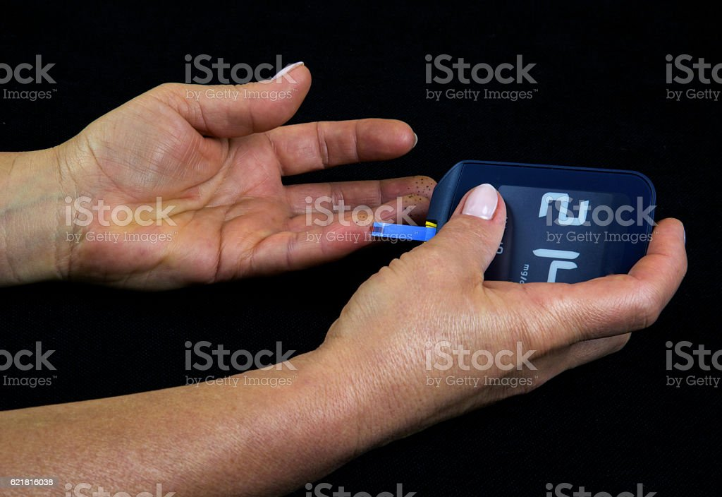 Measuring glucose level in blood stock photo