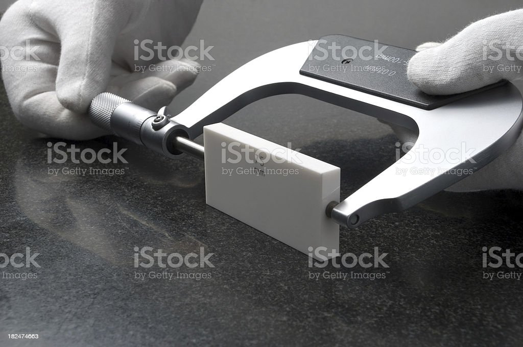 Measuring - hands with micrometer stock photo