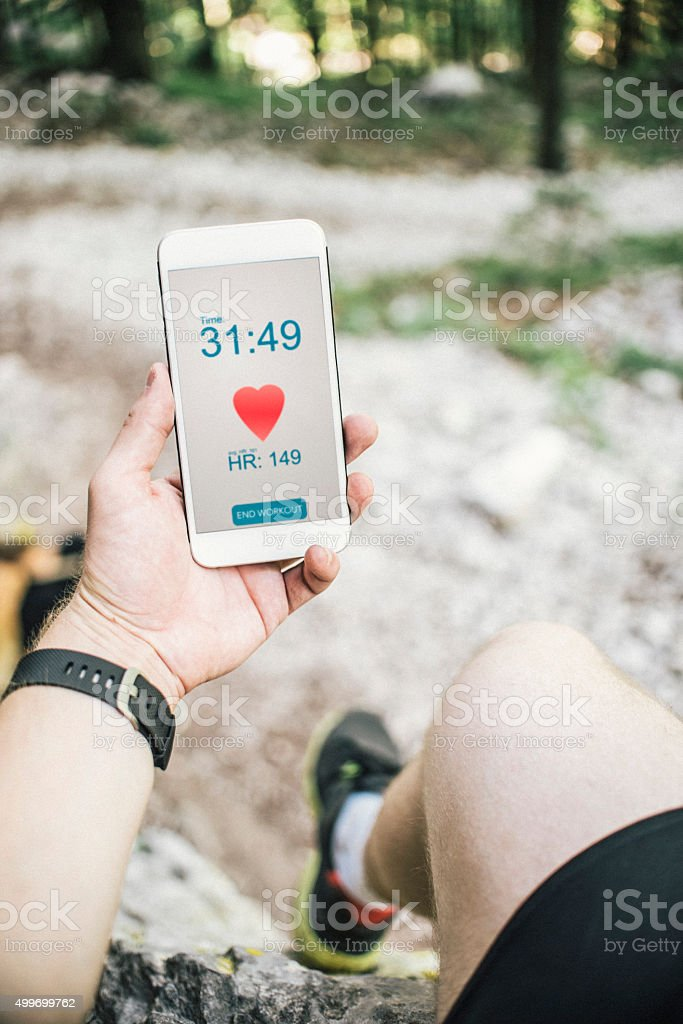 Measuring heart rate in woods stock photo