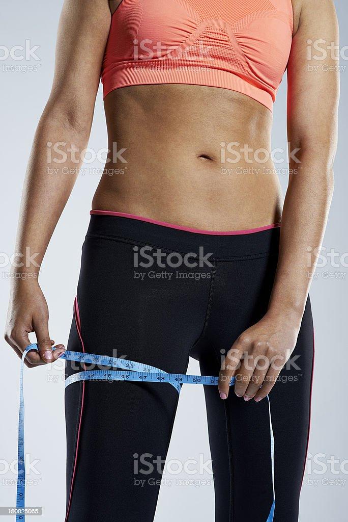 Measuring her waistline royalty-free stock photo