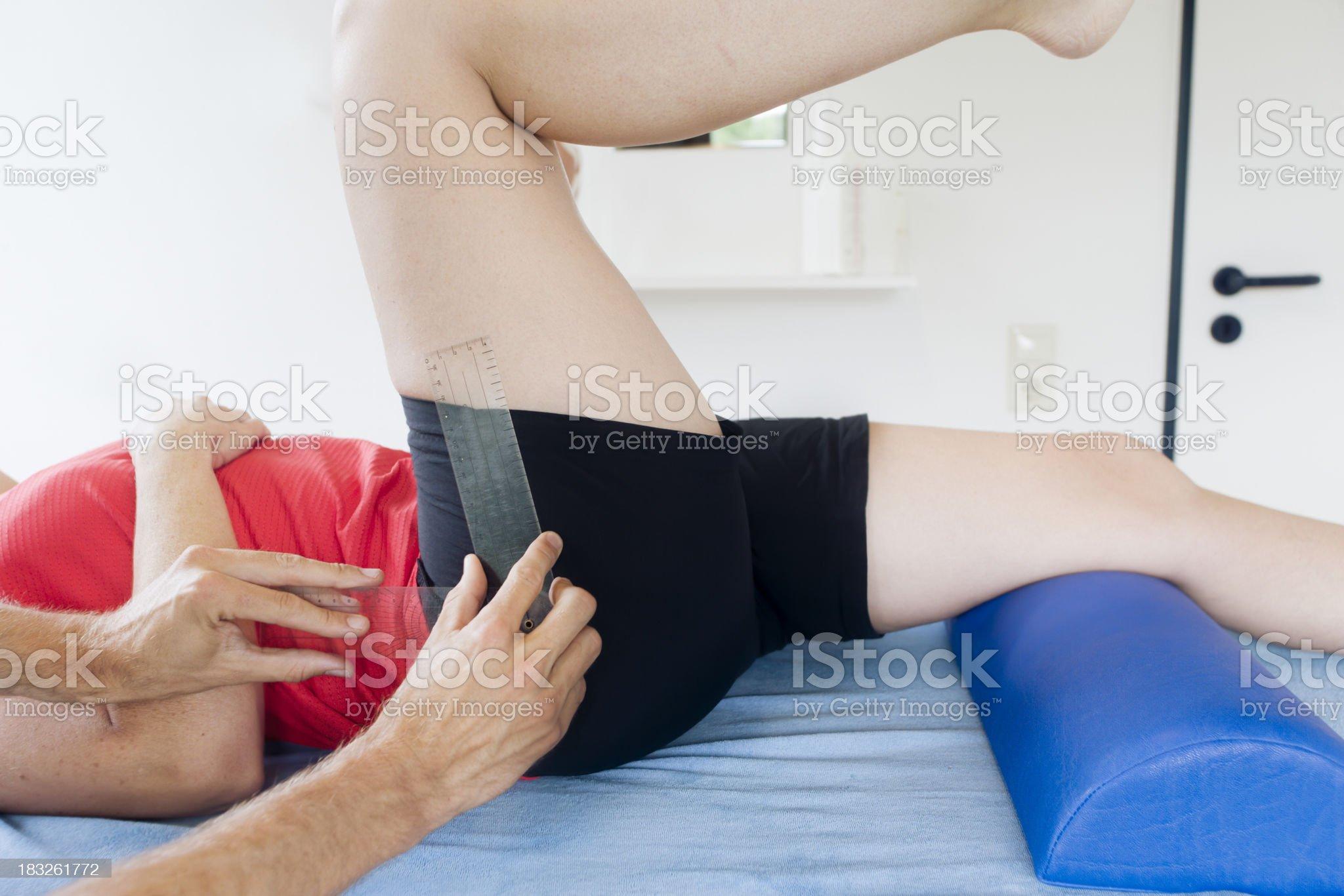 Measuring  hip flexion royalty-free stock photo