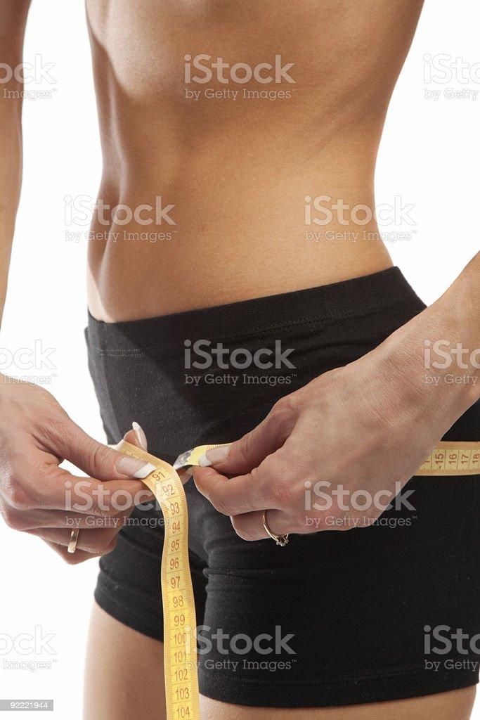 Measuring hips royalty-free stock photo