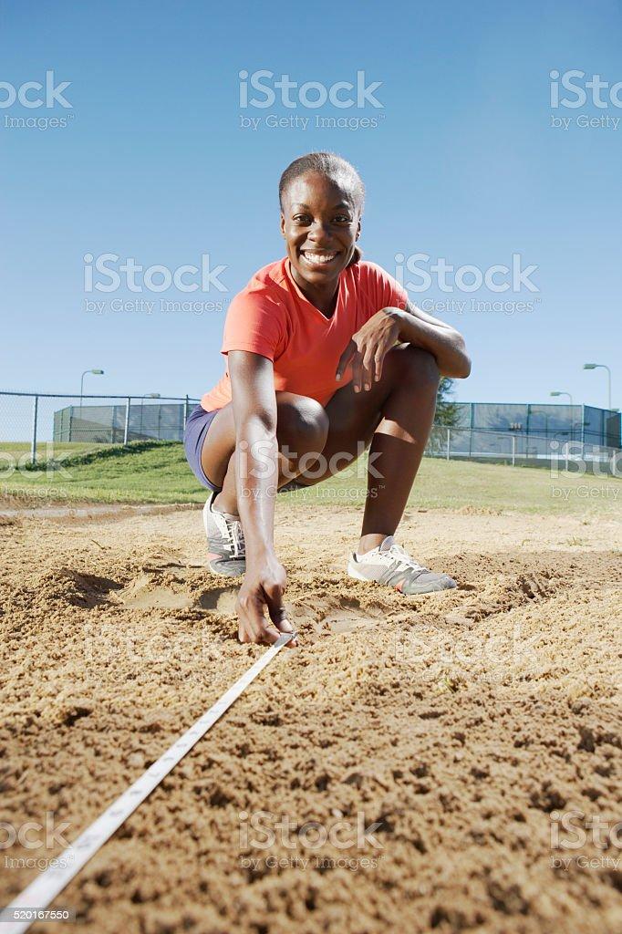 Measuring long jump stock photo