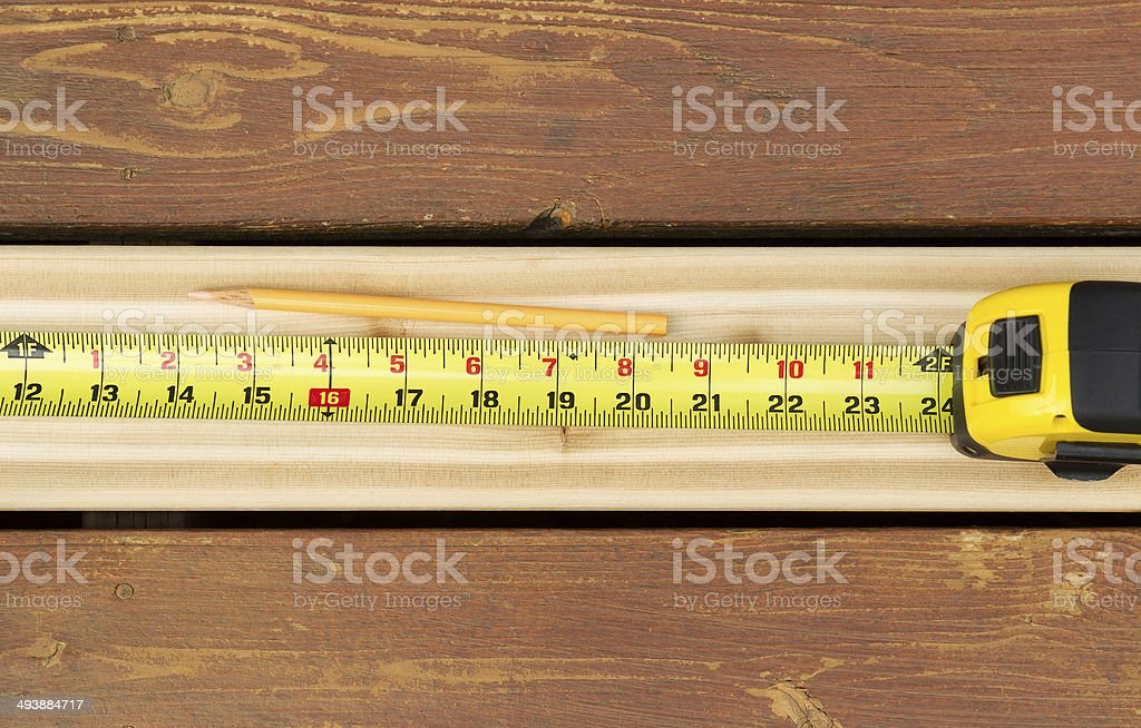 Measuring New Boards for Outdoor Deck stock photo