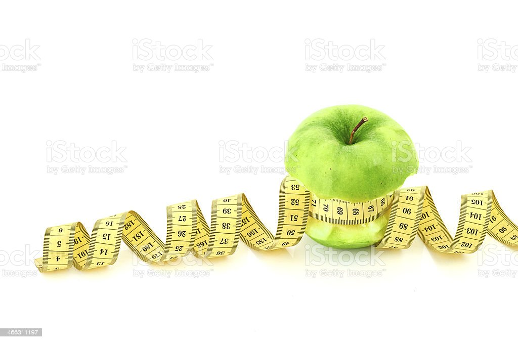 measuring tape and apple royalty-free stock photo