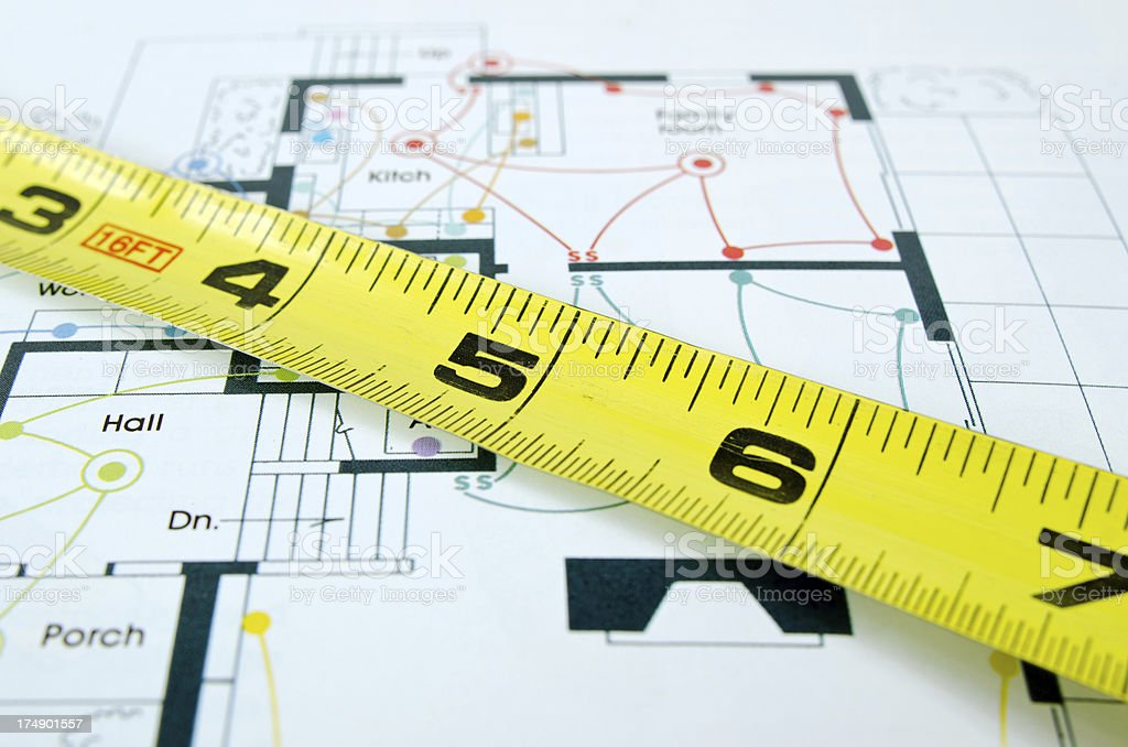 Measuring Tape and House Schematic royalty-free stock photo