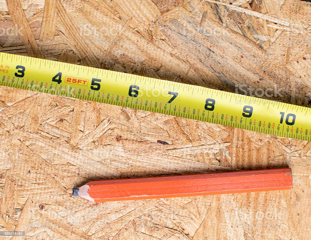 Measuring tape and pencil stock photo