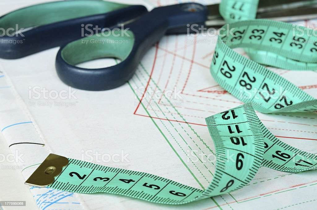 Measuring tape and scissors stock photo