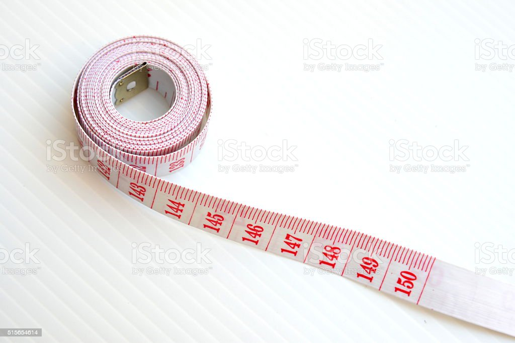 Measuring tape for control your waist stock photo