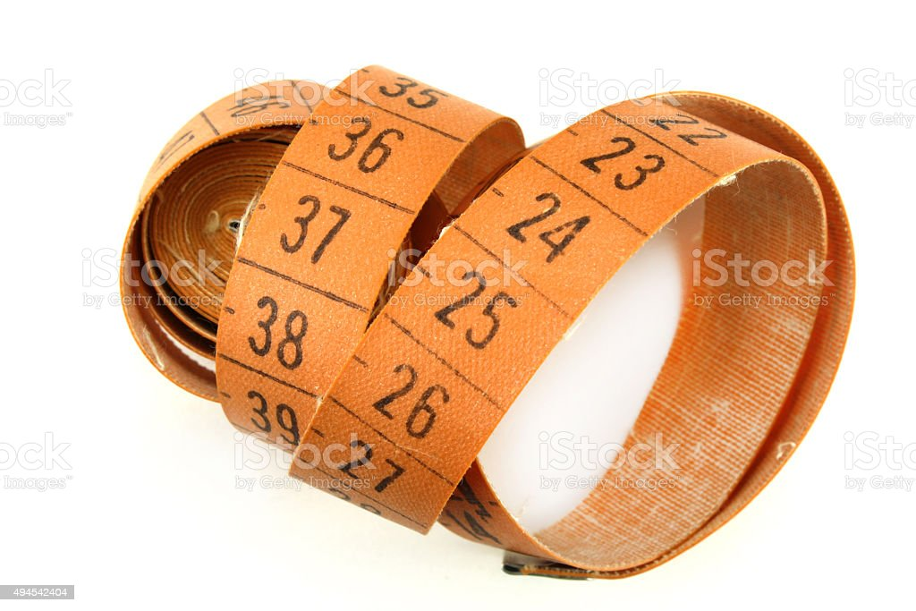 Measuring tape for sewing on a white background stock photo
