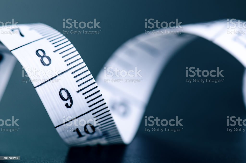Measuring tape on dark background stock photo