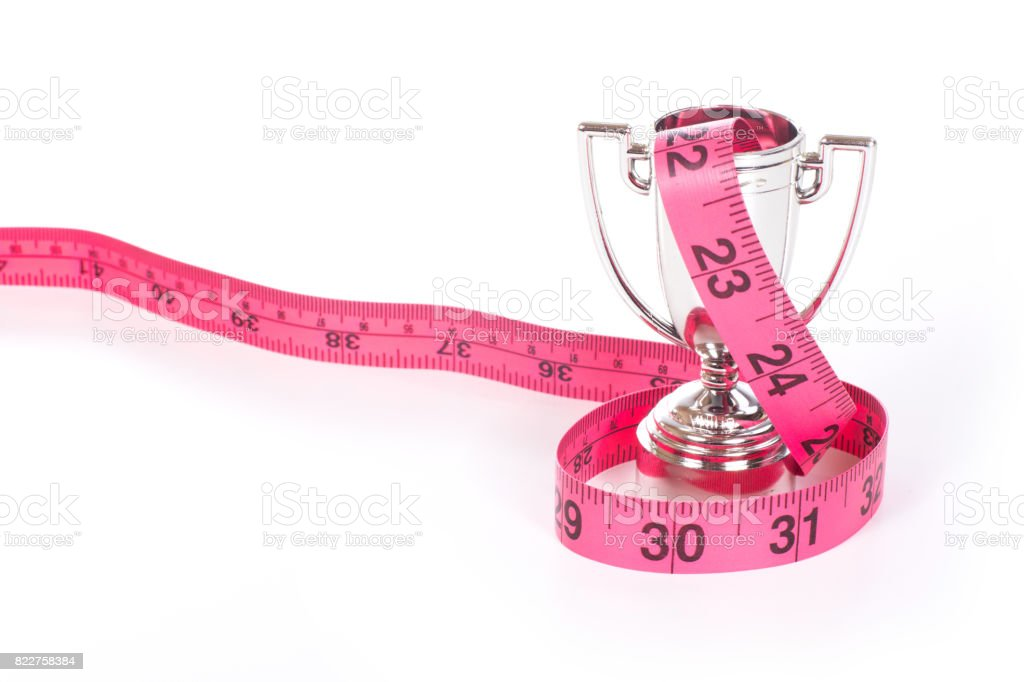 Measuring tape over small sports cup stock photo