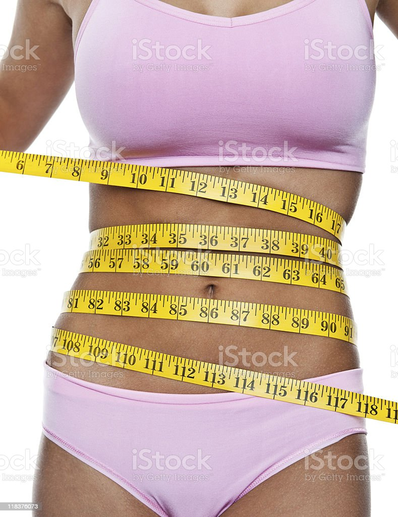 Measuring tape wrapped around a beautiful female body royalty-free stock photo