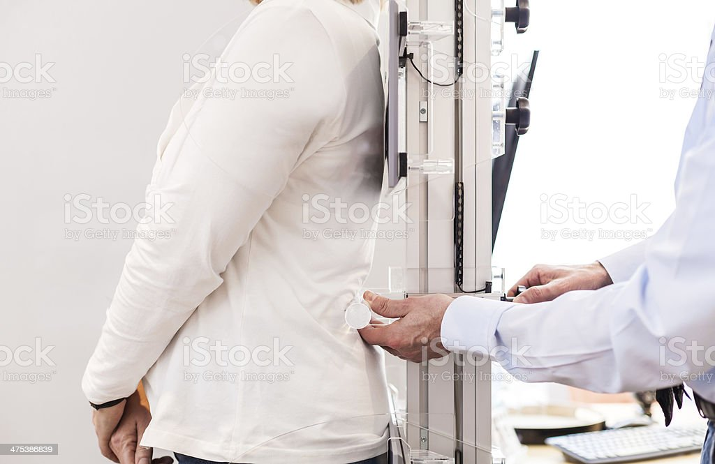 measuring the back of a cusomer stock photo